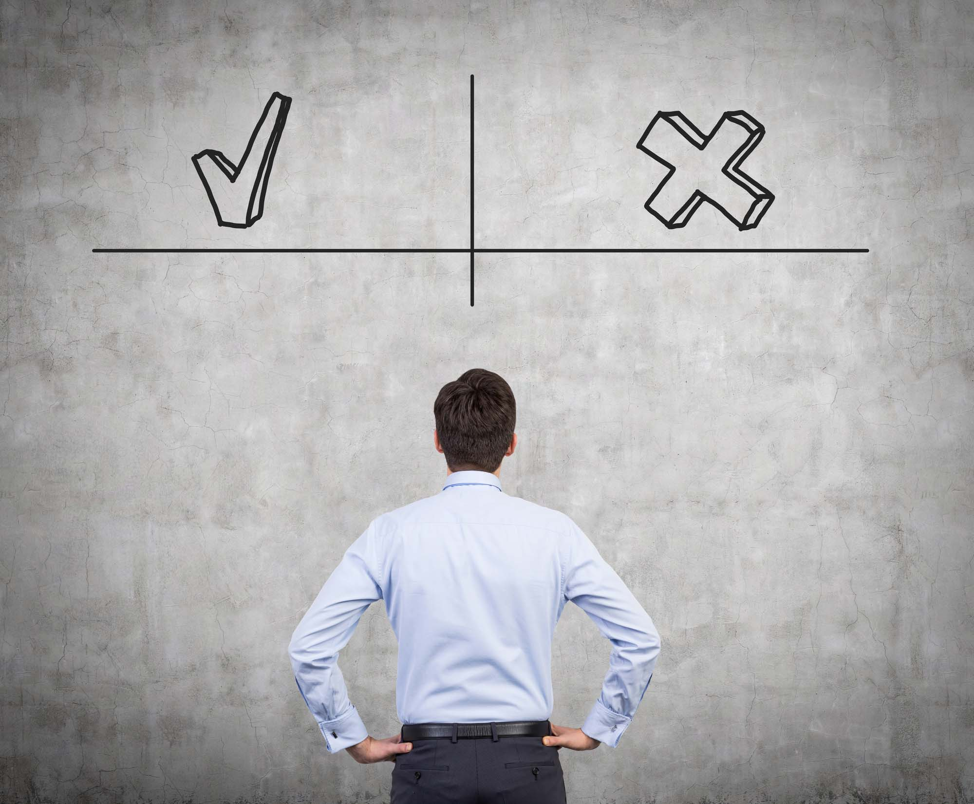 businessman looking at wall with advantages and disadvantages